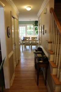 hallway with older hardwood flooring
